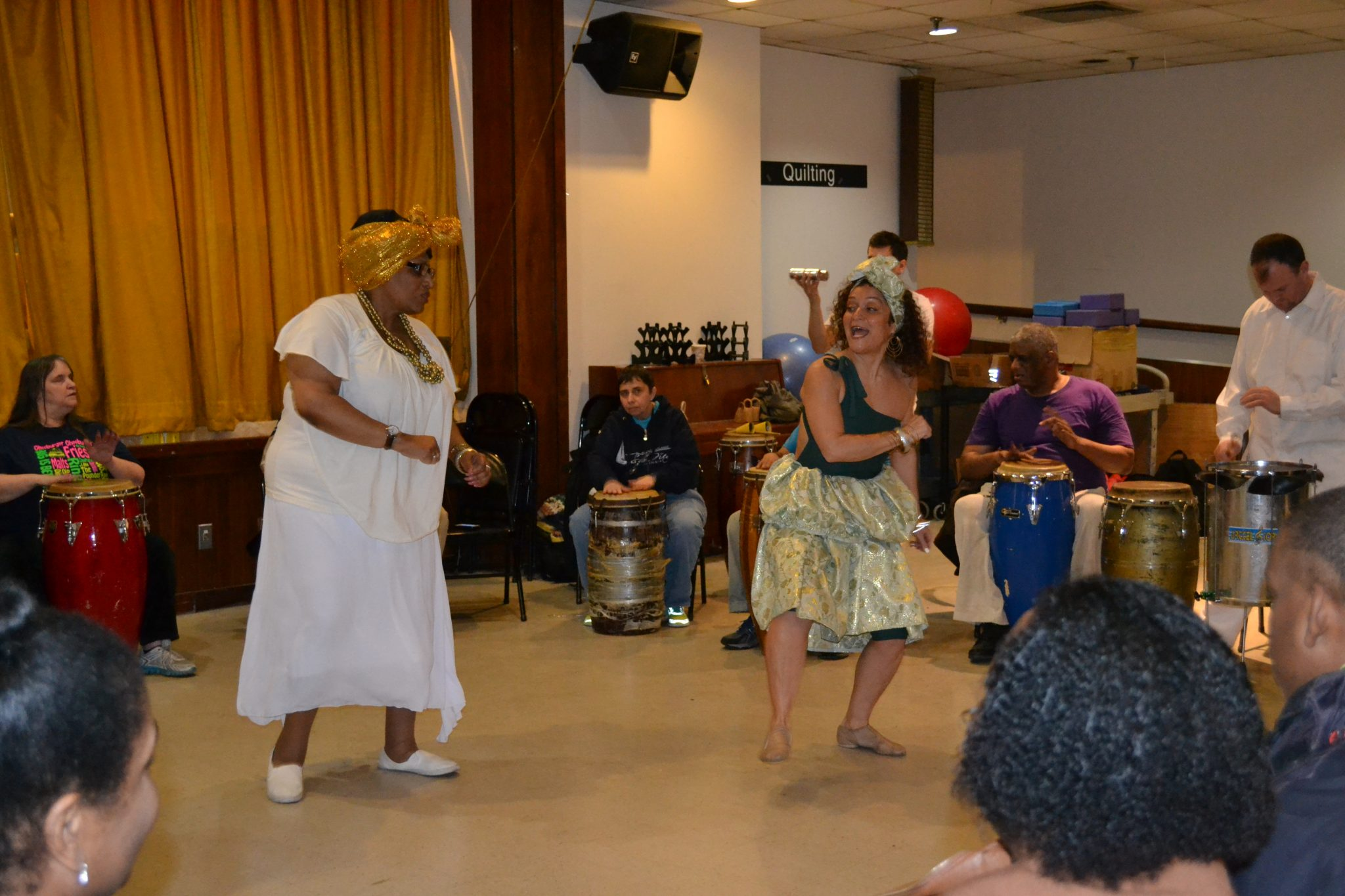 Two women dancing in the middle of a bongo drum circle - Brazillian Drumming and Dance with Turtle Bay Music School