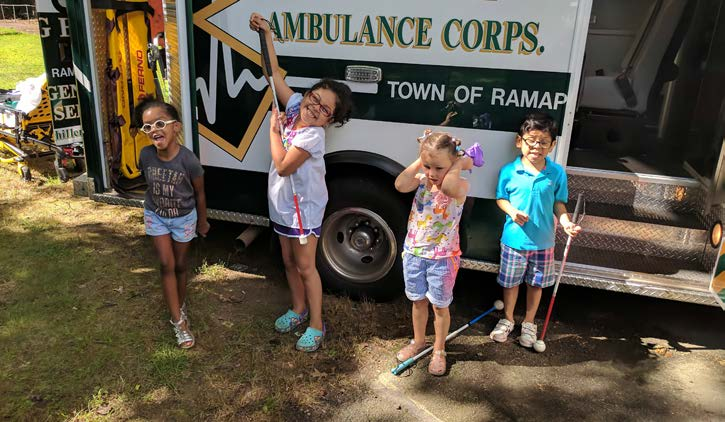 kids playing in front of the ambulance