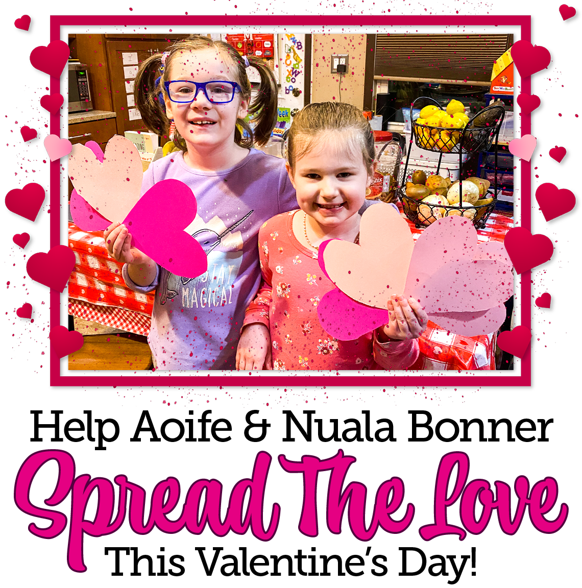 """Aoife and Nuala smile to the camera as they hold up paper hearts. Text beneath reads :Help Aoife and Nuala Bonner spread the love this Valentine's Day!"""""""