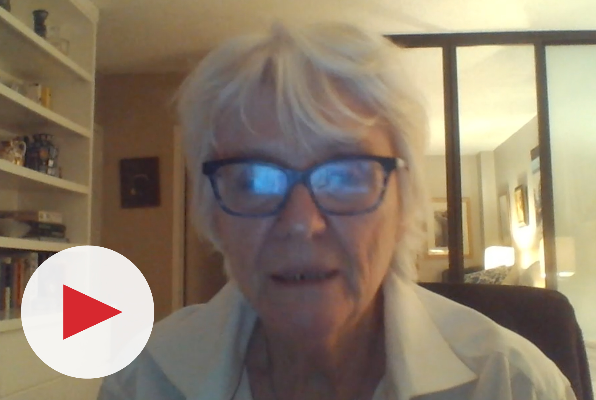 Video thumbnail of an older woman wearing glasses and looking into the camera.